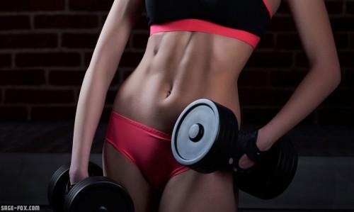 fitnesswomanholdingdumbbells_428784394.jpg