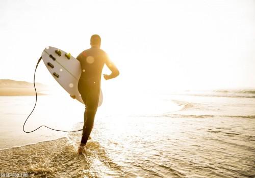 Surferwithhissurfboard_100947914_original.jpg